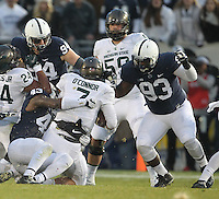 State College, PA - 11/26/2016:  Michigan State QB Tyler O'Connor (7) is tackled by Penn State defenders Manny Bowen (43), Evan Schwan (94), and Antoine White (93). #7 Penn State defeated Michigan State by a score of 45-12 to secure the Big Ten conference East Division championship on Senior Day, Saturday, November 26, 2016, at Beaver Stadium in State College, PA.<br /> <br /> Photos by Joe Rokita / JoeRokita.com