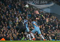 Scott Brown of Celtic wins the ball in the air during the UEFA Champions League GROUP match between Manchester City and Celtic at the Etihad Stadium, Manchester, England on 6 December 2016. Photo by Andy Rowland.
