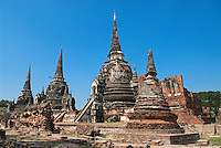 During the height of the Ayutthaya Period in central Thailand, the Grand Palace and Royal Temple of Wat Phra Si Sanphet was one of Asia's grandest palace complexes. The three aligned chedis (stupa) are wonderful examples of the architecture style of Ayutthaya kings and an iconic symbol of the Ayutthaya World Heritage site.