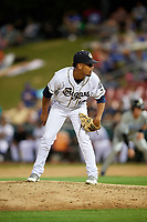 Kane County Cougars relief pitcher Juan Torres (12) looks in for the sign during a game against the West Michigan Whitecaps on July 19, 2018 at Northwestern Medicine Field in Geneva, Illinois.  Kane County defeated West Michigan 8-5.  (Mike Janes/Four Seam Images)
