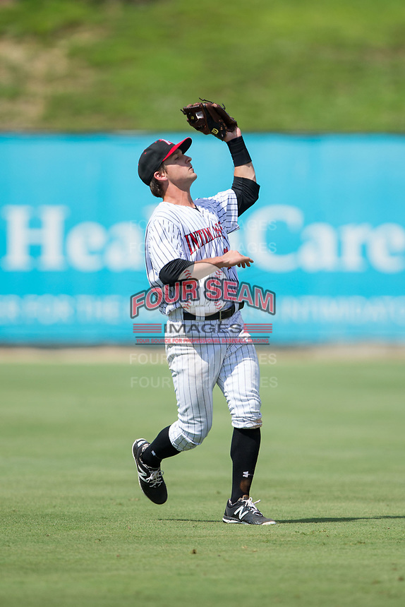 Kannapolis Intimidators shortstop Grant Massey (28) catches a fly ball in shallow left field during the game against the West Virginia Power at Kannapolis Intimidators Stadium on June 18, 2017 in Kannapolis, North Carolina.  The Intimidators defeated the Power 5-3 to win the South Atlantic League Northern Division first half title.  It is the first trip to the playoffs for the Intimidators since 2009.  (Brian Westerholt/Four Seam Images)