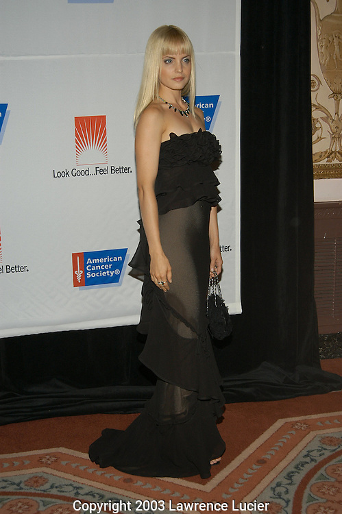 Mena Suvari in a dress by Yves St. Laurent