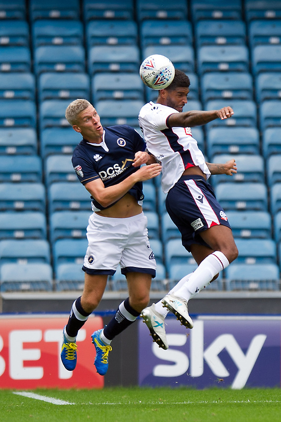 Bolton Wanderers' Mark Little battles for possession with Millwall's Steve Morison<br /> <br /> Photographer Ashley Western/CameraSport<br /> <br /> The EFL Sky Bet Championship - Millwall v Bolton Wanderers - Saturday August 12th 2017 - The Den - London<br /> <br /> World Copyright &not;&copy; 2017 CameraSport. All rights reserved. 43 Linden Ave. Countesthorpe. Leicester. England. LE8 5PG - Tel: +44 (0) 116 277 4147 - admin@camerasport.com - www.camerasport.com