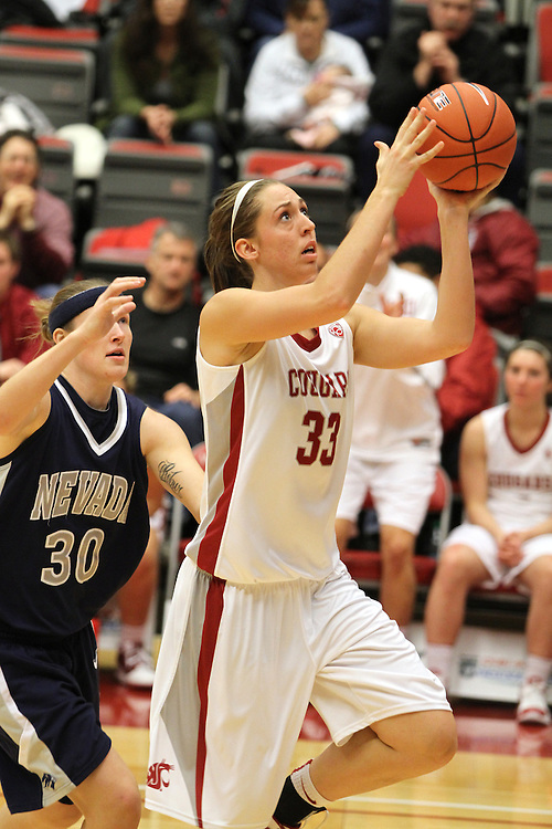 Carly Noyes (#33), Washington State sophomore center, drives for a layup during the Cougars non-conference basketball game against the University of Nevada at Friel Court at Beasley Coliseum in Pullman, Washington, on December 5, 2010.  The Cougars started strong and held on to defeat the Wolfpack, 67-54.
