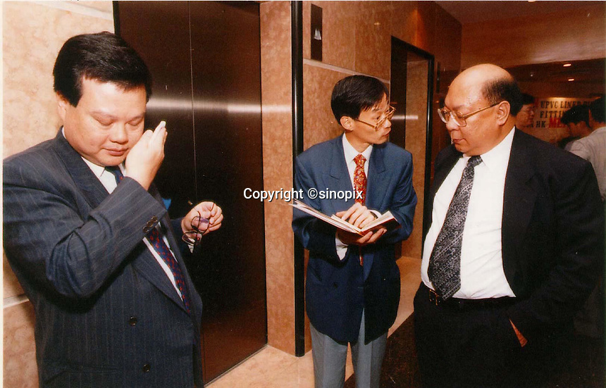 C.K.MA: ORIENTAL PRESS GROUP: HONG KONG<br /> <br />  C.K.Ma (left) leaves a press conference of O.D.N. publishing group. The man on the far right is a chief adviser who is always at his side. (name unknown)