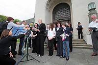 Pictured: Detective Constable for South Wales Police Charmaine Kinson (C) reads a statement on behalf of the family of tragic teen Rebeca Aylward, her mother Sonia is 2nd R  with her other daughter and son who Jack is holding a picture of Rebecca, standing outside Swansea Crown Court. Wednesday 27 July 2011<br />