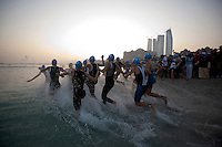 13 MAR 2010 - ABU DHABI, UAE - The elite womens field run into the water at the start of the USD 250,000 Abu Dhabi International Triathlon (PHOTO (C) NIGEL FARROW)