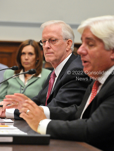 "Washington, D.C. - October 7, 2008 -- Robert B. Willumstad, former Chief Executive Officer, AIG, center, listens to the testimony of Martin J. Sullivan, former Chief Executive Officer, AIG, right, United States House  Committee on Oversight and Government Reform hearing on ""The Causes and Effects of the AIG Bailout"" in the Rayburn House Office Building on Tuesday, October 7, 2008.  The stenographer at left is unidentified..Credit: Ron Sachs / CNP.(RESTRICTION: NO New York or New Jersey Newspapers or newspapers within a 75 mile radius of New York City)"