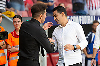 Diego Pablo Cholo Simeone of Atletico Madrid and Miguel Angel Sanchez, Michel of of Rayo Vallecano during the match between Real Madrid v Rayo Vallecano of LaLiga, 2018-2019 season, date 2. Wanda Metropolitano Stadium. Madrid, Spain - 25 August 2018. Mandatory credit: Ana Marcos / PRESSINPHOTO