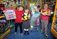 Pictured: Wednesday 08 December 2016<br />Re: Swansea City FC players have bought Christmas gifts for 60 children at Smyths toy store in Swansea, south Wales.