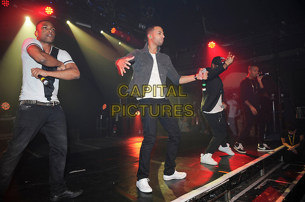 "Jonathan ""JB"" Gill, Marvin Humes, Oritse Williams & Aston Merrygold  .JLS performing live at G-A-Y, Heaven Nightclub, London, England. .27th October 2012.on stage in concert gig performance performing music full length black jeans denim top white dancing side profile .CAP/MAR.© Martin Harris/Capital Pictures."