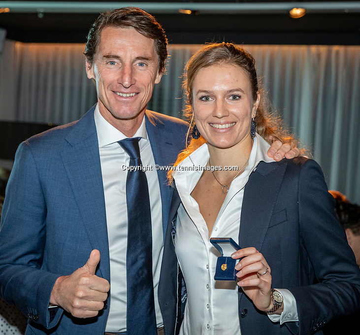 The Hague, The Netherlands, Februari 5, 2020,    Penthouse, FedCup  Netherlands -  Balarus, Official Dinner,  Indy de Vroome (NED) receives a award from Captain Paul Haarhuis.<br /> Photo: Tennisimages/Henk Koster