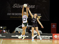 28.07.2015 Silver Ferns Laura Langman and South Africa's Izette Lubbe in action during the Silver Fern v South Africa netball test match played at Trusts Arena in Auckland. Mandatory Photo Credit ©Michael Bradley.