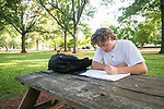 Sophomore Austin Graf studies for his chemistry class at a picnic in the Grove.  Photo by Kevin Bain/University Communications Photography.