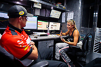Jun 7, 2019; Topeka, KS, USA; NHRA top fuel driver Leah Pritchett (right) talks with a crew member during qualifying for the Heartland Nationals at Heartland Motorsports Park. Mandatory Credit: Mark J. Rebilas-USA TODAY Sports