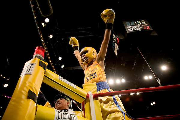 Jose Rivera celebrates his victory over Matthew Williams.. Thursday was the first night of the finals of the  79th annual Golden Glove Boxing tournament. Boxers from all over the New York who made it through the previous rounds were on hand at Madison Square Garden to compete for the coveted Golden Gloves Champion title.