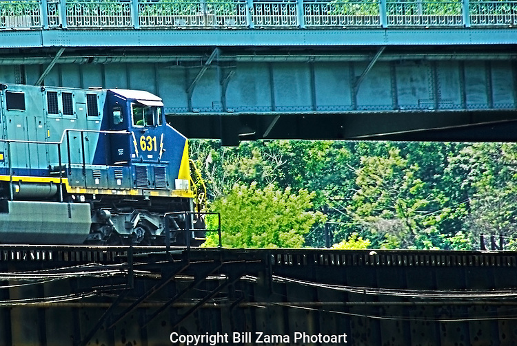 Locomotive entering trestle over the Monongahela River and under a bridge in Pittsburgh PA