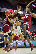 Washington, DC - MAR 7, 2018: La Salle Explorers guard Pookie Powell (0) splits UMass defenders Khalea Turner-Morris (14) and Carl Pierre (12) on his way to the basket during game between La Salle and UMass during first round action of the Atlantic 10 Basketball Tournament at the Capital One Arena in Washington, DC. (Photo by Phil Peters/Media Images International)