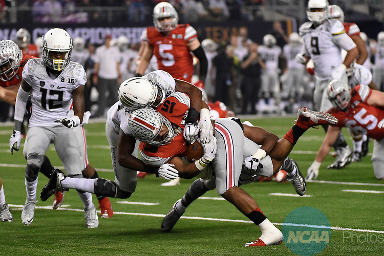 12 JAN 2015:  Ezekiel Elliott (15) of the Ohio State University rushes for a 17 yard gain against the University of Oregon during the College Football Playoff National Championship held at AT&T Stadium in Arlington, TX.  Ohio State defeated Oregon 42-20 for the national title.  Jamie Schwaberow/NCAA Photos