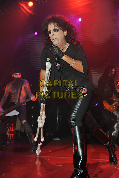 ALICE COOPER.performs live during the first night of Alice Cooper's Halloween Night of Fear 2010, the Roundhouse, Camden, London, England, UK, .31st October 2010..gig concert music  on stage full length black eyeliner make-up gloves leather trousers singing microphone skull bones crutch crutches t-shirt .CAP/MAR.© Martin Harris/Capital Pictures.