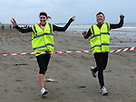 Iris Kelly first lady home and Fran Martin cross the line together in the St Mary's Drumcar 5K run on Bettystown beach. Photo:Colin Bell/pressphotos.ie