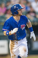 Round Rock Express third baseman Jason Donald (5) runs to first base during the Pacific Coast League baseball game against the Omaha Storm Chasers on June 1, 2014 at the Dell Diamond in Round Rock, Texas. The Express defeated the Storm Chasers 11-4. (Andrew Woolley/Four Seam Images)