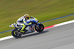 KUALA LUMPUR, MALAYSIA - OCTOBER 24:  Valentino Rossi of Italy rides the #46 Fiat Yamaha Team Yamaha during free practice for the Malaysian MotoGP, which is round 16 of the MotoGP World Championship at the Sepang Circuit on October 24, 2009 in Kuala Lumpur, Malaysia. Photo by Victor Fraile / The Power of Sport Images