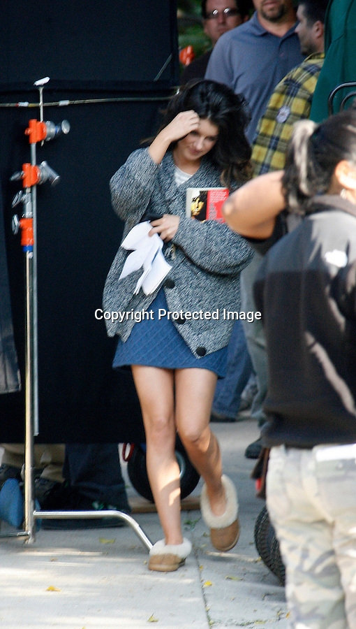 November 16th 2010 ..Shenae Grimes filming the tv show 90201 at a house in Los Angeles. Shenae was wearing a short blue skirt with a brown leather belt around her waist & a white & gray striped shirt with leather boots & purse to match. During break Shenae gave her security guard a big hug while wearing her Ugg slippers carrying her cell phone, script & a Jim Morrison The Doors book. Shenae was using her food to cover up her face while walking with her hot male co-star. ..AbilityFilms@yahoo.com.805-427-3519.www.AbilityFilms.com.