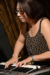 DC Stage, Kaohsiung -- Keyboard player Ni-Li Tang of SMALLS JAZZ COMBO during a performance.