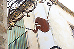 Metal iron monkey street decoration in medieval old town, Caceres, Extremadura, Spain