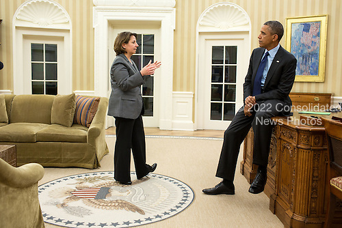 United States President Barack Obama receives an update on the Boston bombing investigation from Lisa Monaco, Assistant to the President for Homeland Security, following the apprehension of the second suspect, April 19 2013..Mandatory Credit: Pete Souza - White House via CNP