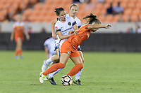 Houston, TX - Saturday July 08, 2017: Ashleigh Sykes and Andressa Cavalari Machry battle for control of the ball  during a regular season National Women's Soccer League (NWSL) match between the Houston Dash and the Portland Thorns FC at BBVA Compass Stadium.