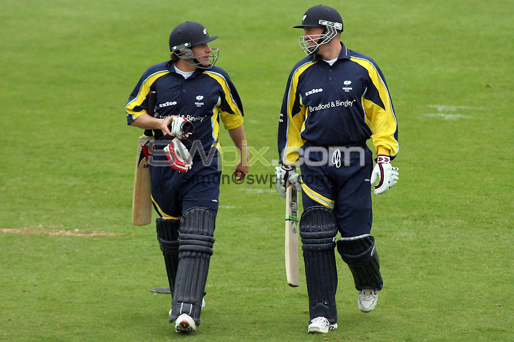 PICTURE BY VAUGHN RIDLEY/SWPIX.COM -  Cricket - C&G Trophy - Yorkshire v Warwickshire - Headingley, Leeds, England - 21/05/06...? Simon Wilkinson - 07811 267706...Yorkshire's Matthew Wood (L) and captain Craig White (R) leave the field as play is stopped due to rain.