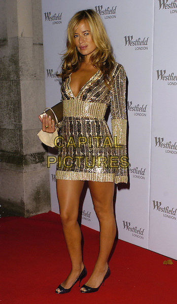 JADE JAGGER.Westfield Launch Party for London Fashion Week,.BFC Tent, Natural History Museum, London,.England, September 17th 2006..full length gold beaded tunic dress low cut plunging neckline.Ref: CAN.www.capitalpictures.com.sales@capitalpictures.com.©Can Nguyen/Capital Pictures