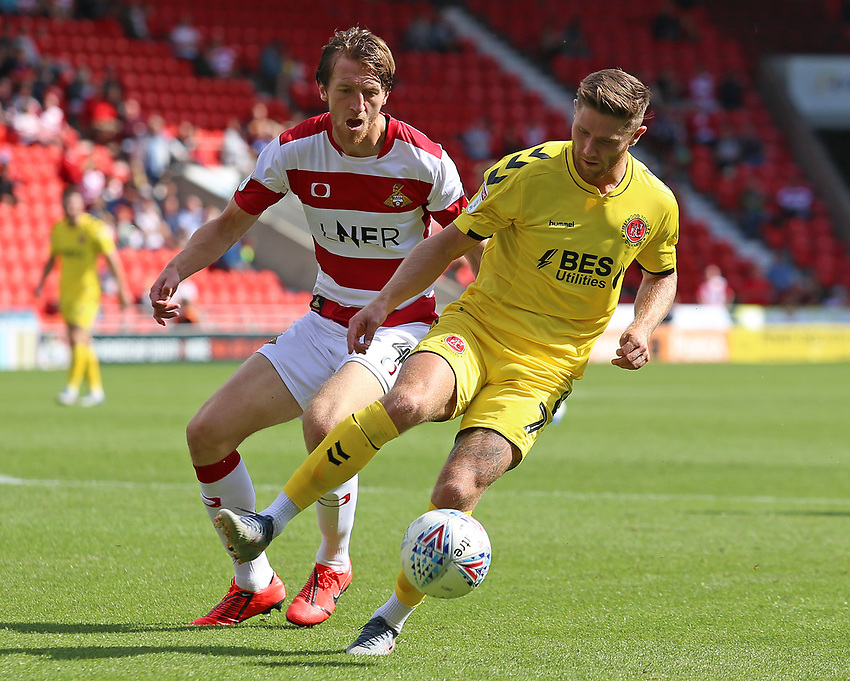 Fleetwood Town's Wes Burns shields the ball from Doncaster Rovers' Tom Anderson<br /> <br /> Photographer David Shipman/CameraSport<br /> <br /> The EFL Sky Bet League One - Doncaster Rovers v Fleetwood Town - Saturday 17th August 2019  - Keepmoat Stadium - Doncaster<br /> <br /> World Copyright © 2019 CameraSport. All rights reserved. 43 Linden Ave. Countesthorpe. Leicester. England. LE8 5PG - Tel: +44 (0) 116 277 4147 - admin@camerasport.com - www.camerasport.com