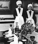 Parlourmaid and Under Parlourmaid ready to serve dinner 1939