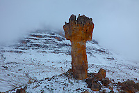 Maltese Cross in snow.Cederberg  Wilderness,  South Africa.Table Mountain sandstone .150 foot tall pinnacle .Sneeuberg Mountain (highest in range) beyond