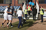 Dundee 0 Greenock Morton 1, 27/08/2011. Dens Park, Scottish League First Division. Dundee substitute Jake Hyde is helped back to the dressing room at the end of a Scottish League First Division match at Dens Park stadium against visitors Greenock Morton. The visitors won by one goal to nil watched by a crowd of 4,096. Dundee  stadium was situated on the same street as their city rival Dundee United, whose Tannadice Park ground was situated a few hundred yards away.