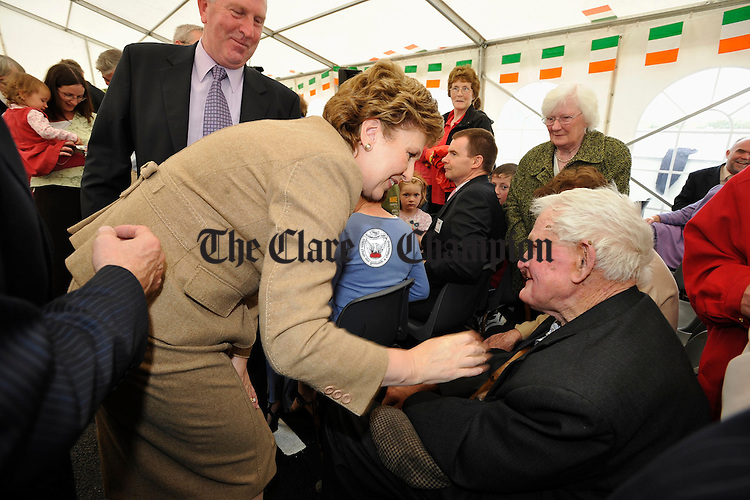 President Mary Mc Aleese chats local man Anthony Frawley at the official opening of the Ark Creche at Inagh. Photograph by John Kelly.
