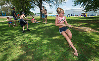 NWA Democrat-Gazette/BEN GOFF @NWABENGOFF<br /> Hayden Fry, 10, of Rogers, London Swann, 12, of Bentonville and Taylor Fry (Hayden's sister), 11, give it their all in a game of tug of war Tuesday, Aug. 6, 2019, during the Summer Day Camp at the Rogers Activity Center. This week's camp is the center's final session of the summer season.