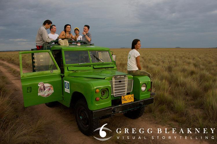 A group of conservationalist enjoy a chocolate break while on Safari in la Reserva Natural Bojonawi - Orinoco River Basin - Colombia - South America
