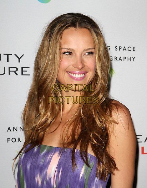 PETRA NEMCOVA .at The opening of Beauty Culture - a photographic exploration of how feminine beauty is defined, challenged and revered in modern society held at Annenberg Space for Photography in Century City, California, USA,.May 19th 11..portrait headshot smiling strapless purple white ikat print  green .CAP/ADM/KB.©Kevan Brooks/AdMedia/Capital Pictures.