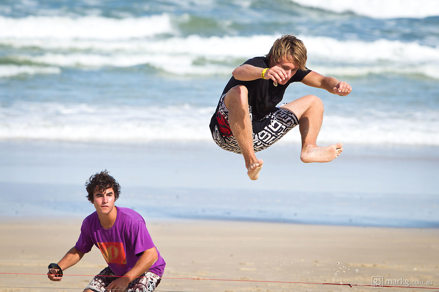 The last leg of the 2010 PKRA World Kiteboarding Tour has come to the Gold Coast, Australia - Boredom sets in & the guys try their hand at kite line jumping. Not an easy thing to do especially since the kite is moving & you have to jump the lines as it goes past...