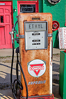 The Conoco gas station on the west end of main street in Commerce Oiklahoma was first operated around 1930.  The unique structure was built onto the side of the last building on main street and resembles a french cottage style building.  The station has been restored by Carl and Linda Allen and now serves as a gift shop and museum.