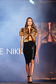 Model walking down the runway wearing a fur top for the Roxanne Nikki fashion show