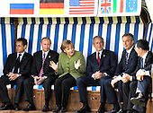 Heiligendamm, Germany - June 7, 2007 -- The G-8 Heads of State and Government seated in a wicker beach chair (from left to right) President Nicolas Sarkozy of France, President Vladimir Putin of Russia, Chancellor Angela Merkel of Germany, United States President George W. Bush, Prime Minister Tony Blair of the United Kingdom, and Prime Minister Romano Prodi of Italy..Mandatory Credit: BPA via CNP.