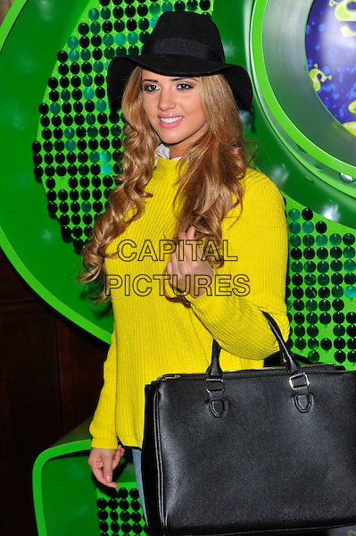 "Lucy Mecklenburgh.Attends the Shrek ""Children in Need"" Performance, Theatre Royal, Dury Lane, Covent Garden, London, England..November 14th, 2012.half length black yellow top hat bag purse.CAP/CJ.©Chris Joseph/Capital Pictures."
