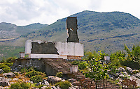 A strange abstract monument statue probably an heroic war monument very near the border to Montenegro on the road to Shkodra with the Kastrat Shkrel mountains in the background. Albania, Balkan, Europe.