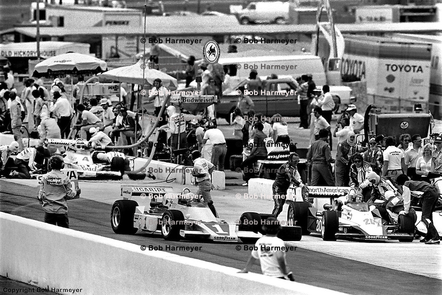 HAMPTON, GA - APRIL 22: Tom Sneva (#1 McLaren M24/Cosworth TC), Gordon Johncock (#20 Penske PC6/Cosworth TC), and Johnny Rutherford (McLaren M24B/Cosworth TC) make pit stops during the Gould Twin Dixie 125 event on April 22, 1979, at Atlanta International Raceway near Hampton, Georgia.