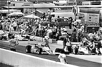 HAMPTON, GA - APRIL 22: Tom Sneva (#1 McLaren M24/Cosworth TC), Gordon Johncock (#20 Penske PC6/Cosworth TC), and Johnny Rutherford (McLaren M24B/Cosworth TC) make pit stops during the Gould Twin Dixie 125 event on April 22, 1979, at Atlanta International Raceway near Hampton, Georgia.